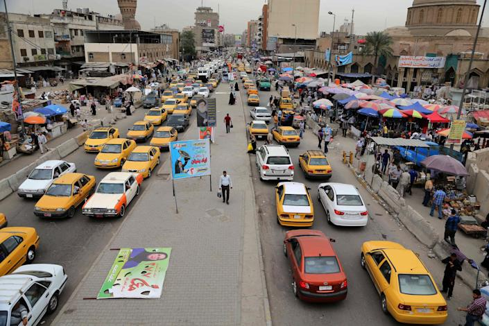 In this photo taken on Sunday, April 27, 2014, cars stand still in a traffic jam in central Baghdad, Iraq. As parliamentary elections are held Wednesday, April 30, more than two years after the withdrawal of U.S. troops, Baghdad is once again a city gripped by fear and scarred by violence. (AP Photo/Karim Kadim)