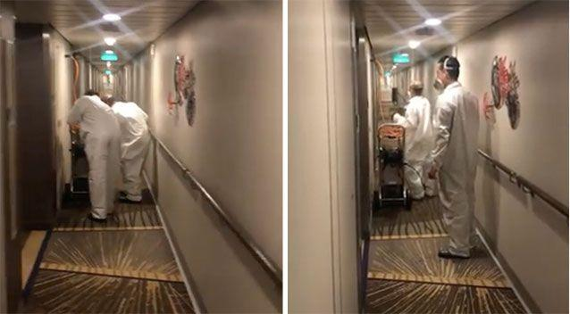 Industrial suit-clad crew members spraying the boat's hallways. Source: Ash on the Ovation/Facebook