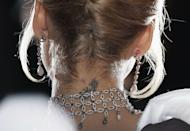 """<p>Even celebrities do things when they're younger that they regret later in life. For Jessica Alba, one of those things is the flower tattoo she got on the back of her neck when she was 17. """"I'm so irritated that I got it,"""" the Honest Company founder told <a href=""""https://www.refinery29.com/en-us/2019/07/238117/jessica-alba-honest-beauty-lipstick-tattoos-interview"""" rel=""""nofollow noopener"""" target=""""_blank"""" data-ylk=""""slk:Refinery29"""" class=""""link rapid-noclick-resp"""">Refinery29</a>. """"I got it lasered many times and it's not coming out."""" Jessica said she also has a bow in the middle of her lower back that feels like """"kind of a tramp stamp"""" that she wishes she hadn't gotten.</p><p>But three tattoos she'll never regret? The zodiac signs' constellations of her three kids that she has on her left arm.</p>"""