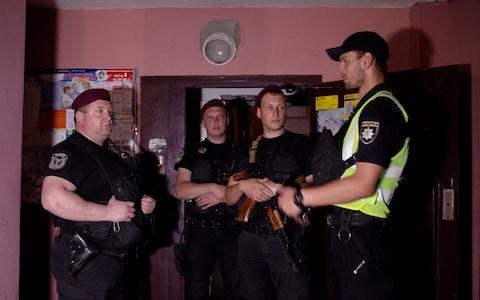 <span>Ukrainian police officers guard in the entrance to Babchenko's home in Kiev after his body was found</span>
