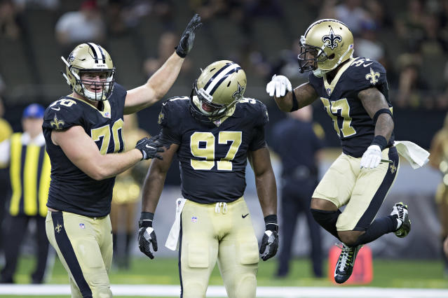 "<a class=""link rapid-noclick-resp"" href=""/nfl/teams/nor"" data-ylk=""slk:Saints"">Saints</a> defensive lineman <a class=""link rapid-noclick-resp"" href=""/nfl/players/29856/"" data-ylk=""slk:Mitchell Loewen"">Mitchell Loewen</a>, left, helped rescue a man who was trapped in his car after it fell from the fourth floor of a New Orleans parking garage on Sunday. (Getty Images)"
