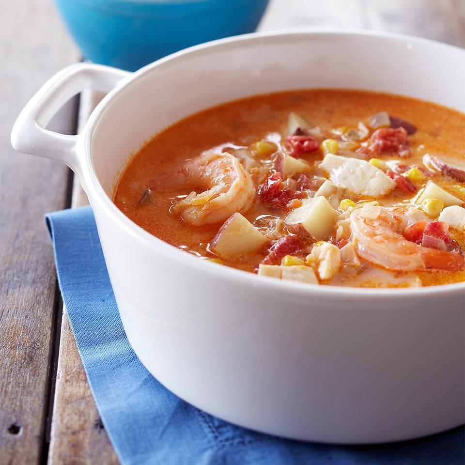 <p>A tomato-based broth made with reduced-fat cream cheese and fat-free milk is the backdrop for this delicious fish chowder that's bursting with flounder, shrimp, corn, and potatoes.</p>