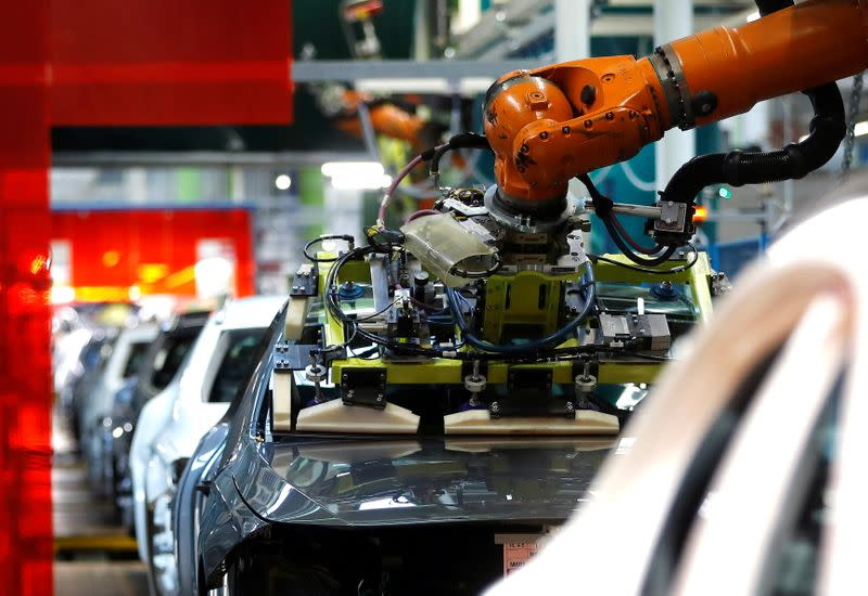 FILE PHOTO: A robot engineered by Kuka adjusts a windscreen in a fully automated process on a model of the A-class production line of German car manufacturer Mercedes Benz at the Daimler factory in Rastatt