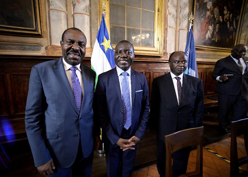L-R: National Convergence Kwa Na Kwa party general secretary Bertin Bea, Republic of Central Africa foreign minister Charles Armel Doubaned and Central African president political advisor George Isidore Alphonse Dibert pose on June 19, 2017 in Rome