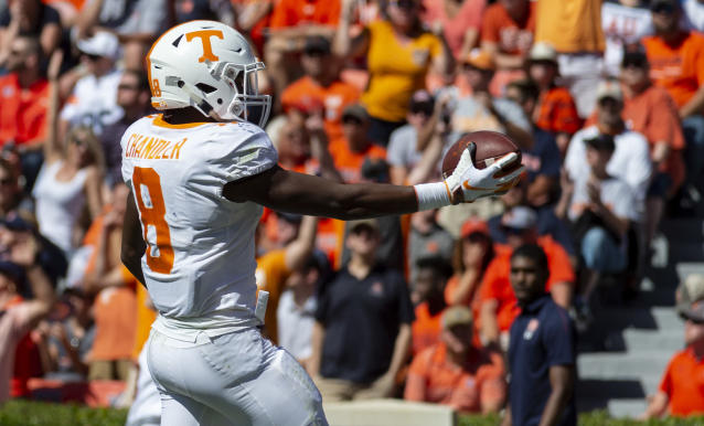 Tennessee running back Ty Chandler (8) runs in a 42-yard pass for a touchdown again Auburn during the first half of an NCAA college football game, Saturday, Oct. 13, 2018, in Auburn, Ala. (AP Photo/Vasha Hunt)