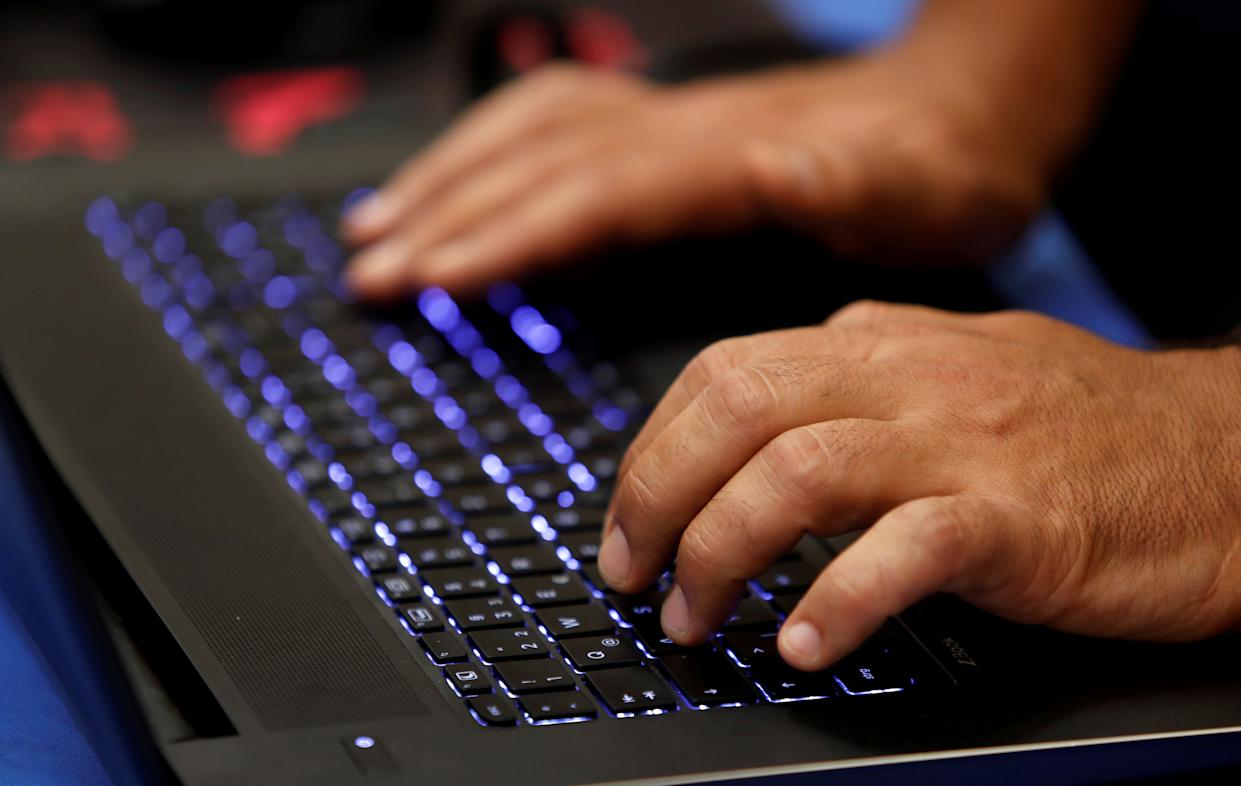 A man types into a keyboard during the Def Con hacker convention in Las Vegas, Nevada, U.S. on July 29, 2017. REUTERS/Steve Marcus