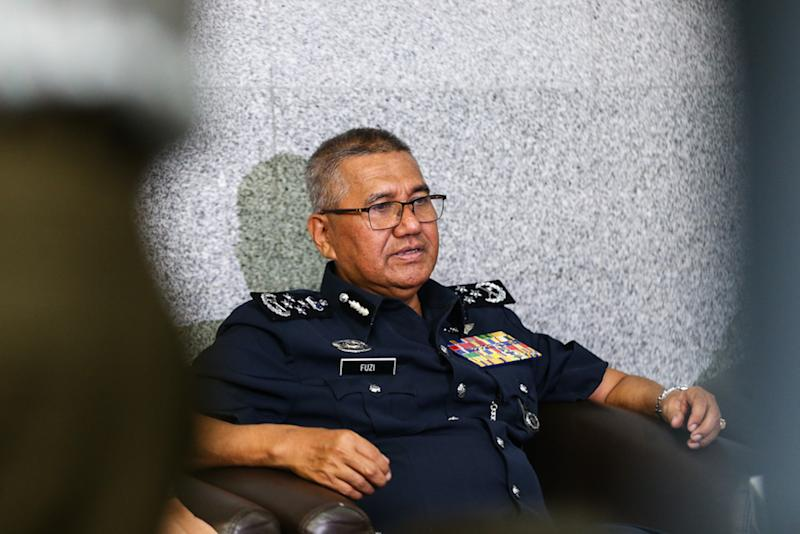 Sarawak Report reported that IGP Tan Sri Mohamad Fuzi Harun (pic) had taken at least 16 high ranking officers to Istanbul for a work trip, estimating that RM312,441 could have been spent on just business class flights and hotels for the group. — Picture by Ahmad Zamzahuri