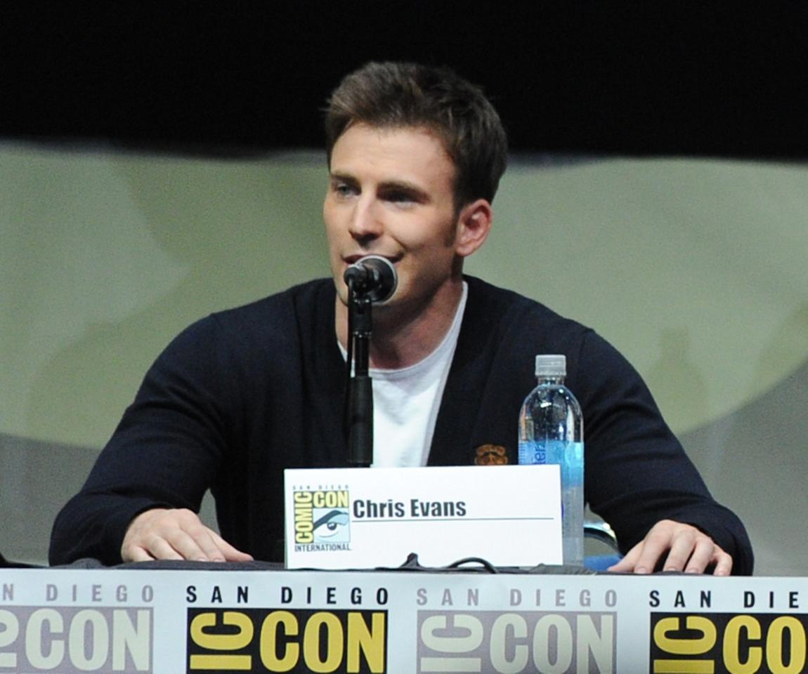 "SAN DIEGO, CA - JULY 20: Actor Chris Evans speaks onstage at Marvel Studios ""Thor: The Dark World"" and ""Captain America: The Winter Soldier"" during Comic-Con International 2013 at San Diego Convention Center on July 20, 2013 in San Diego, California. (Photo by Kevin Winter/Getty Images)"