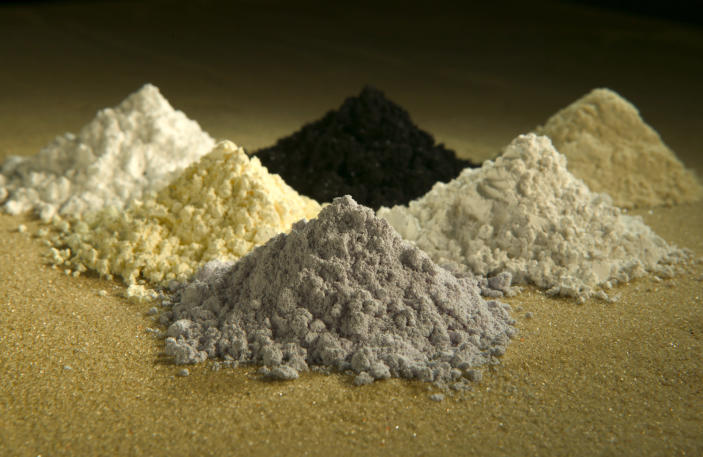 In this undated photo released by the U.S. Department of Agriculture are rare-earth oxides, clockwise from top center: praseodymium, cerium, lanthanum, neodymium, samarium, and gadolinium. Across the West, early miners digging for gold, silver and copper had no idea that one day something even more valuable would be hidden in the piles of dirt and rocks they tossed aside. Now there's a rush in the U.S. to find key components of cellphones, televisions, weapons systems, wind turbines, MRI machines and the regenerative brakes in hybrid cars, a group of versatile minerals on the periodic table called rare earth elements and old mining tailings piles just might be the answer. (AP Photo/U.S. Department of Agriculture, Peggy Greb)