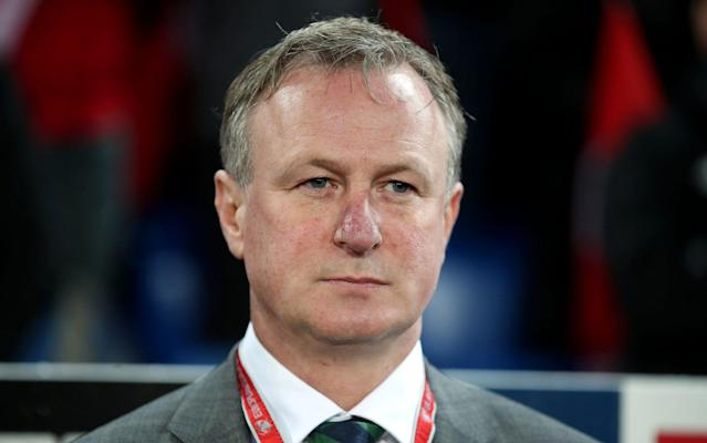 """Michael O'Neill returned to his Edinburgh home late on Monday afternoon to find that the bookmakers had not only installed him as favourite for the vacant Scotland manager's job but had made him third favourite for the similarly unfilled position at Rangers. Sensibly, the Northern Ireland manager will take a couple of days to reflect on the outcome of the World Cup play-off which saw Switzerland progress to the finals in Russia next summer thanks to the award of a nonsensical penalty kick in the first leg in Belfast. O'Neill's position, as stated after Sunday's goalless draw in Basel, is that he is under contract to the Irish Football Association and that it would be improper to speak about other positions. That said, at the age of 48 and after six years with the Northern Ireland team, it would be remarkable if O'Neill were not contemplating a fresh start and there must also be an allure in the prospect of a switch to day-to-day involvement at club level rather than the spasmodic challenge of the international game. The utterances of Stewart Regan, chief executive of the Scottish Football Association, have been scrutinised for clues to what might transpire at Hampden Park. With no interest in the World Cup finals, following failure to clear the group stage qualifying hurdles under Gordon Strachan the Scots have a friendly in Morocco in March and another in early summer before they resume competitive action in the Uefa Nations League next September. """"We might have a new manager in place for those friendlies, but if we haven't, it's not the end of the world,"""" Regan said last month when announcing that Malky Mackay would act as interim manager for the friendly meeting with Holland at Pittodrie, which Scotland lost 1-0 last Thursday. One immediate assumption was that the SFA had identified O'Neill as its principal target and were prepared to wait, if Northern Ireland were to reach the finals. Sam Wallace's Power Rankings 42:04 Regan also revealed on the day of the Dutch"""