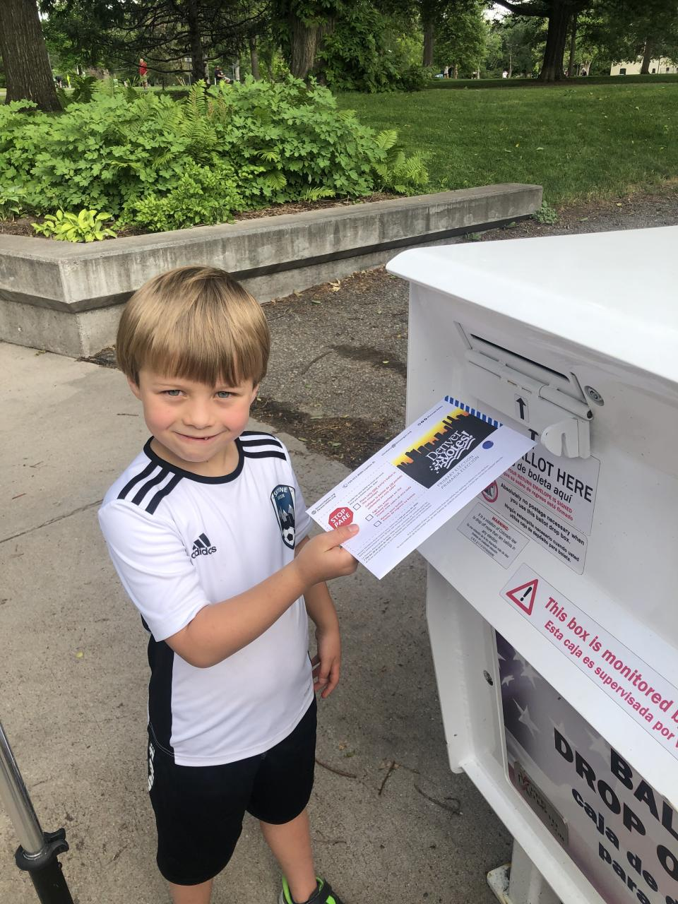 "McReynolds' son Kenton, 7, helping her vote during Colorado's primary election this summer.<span class=""copyright"">Courtesy of Amber McReynolds</span>"