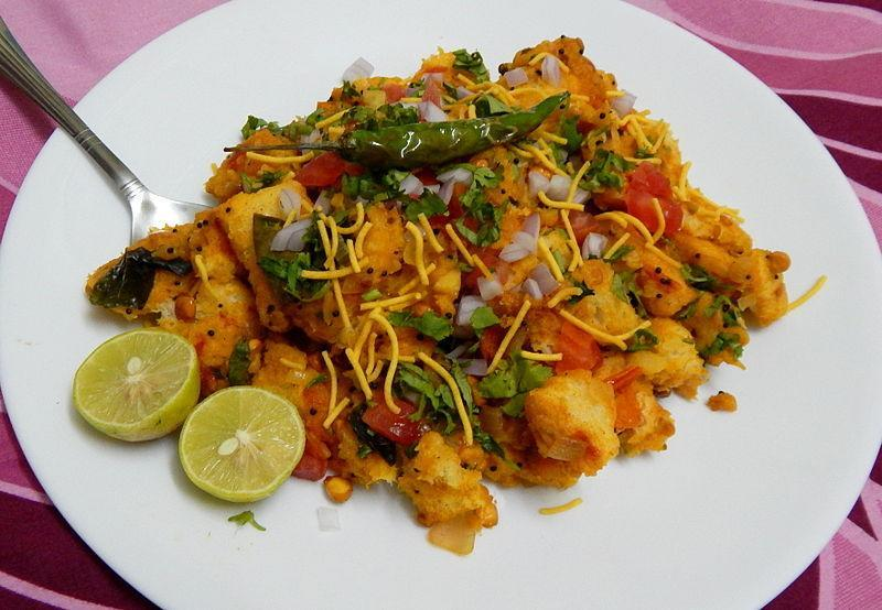 """<p>A quick breakfast dish, bread poha can be made in 15 minutes. Heat 1 tsp oil in a kadhai & add some mustard seeds & fry till they crackle. Add some curry leaves & one chopped onion & saute. Add little turmric powder, chopped green chilies & one boiled & chopped potato. Cover with a lid & let it cook for 5 minutes. Add 5-6 slices of broken white bread slices & salt to taste. Stir well & cook for 5 minutes. Add lemon juice to taste & garnish with chopped coriander before serving. """"Creative Commons Bread poha"""" by Kanikatwl is licensed under CC BY 4.0 </p>"""