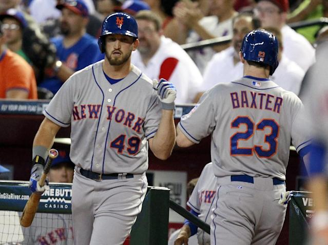 New York Mets' Jonathon Niese (49) and Mike Baxter (23) celebrate after Baxter scores in the first inning of a baseball game against the Arizona Diamondbacks on Sunday, Aug. 11, 2013, in Phoenix. (AP Photo/Rick Scuteri)