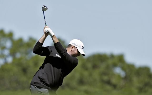 Robert Garrigus tees off on the sixth hole during the first round of the Valspar Championship golf tournament Thursday, March 13, 2014, in Palm Harbor, Fla. (AP Photo/Chris O'Meara)