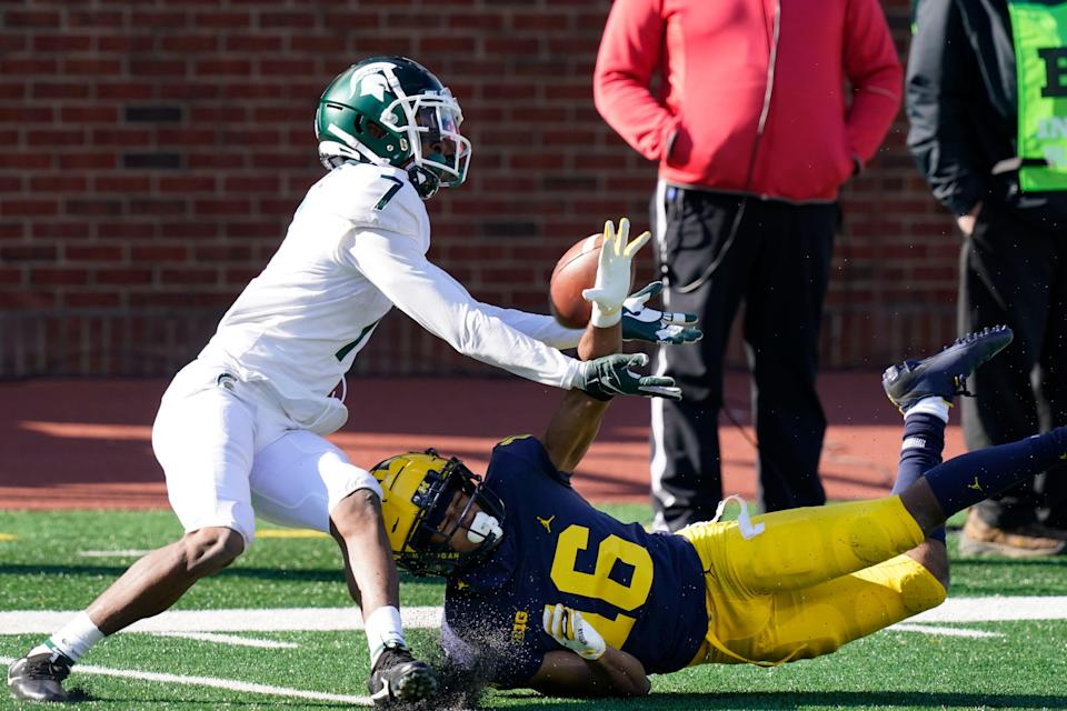Michigan State Spartans receiver Ricky White makes a catch against Michigan Wolverines cornerback Jalen Perry during the fourth quarter Saturday, Oct. 31, 2020, in Ann Arbor.