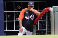 Washington Nationals manager Dave Martinez (4) watches from the dugout as his team plays the Atlanta Braves in a baseball game Thursday, June 3, 2021, in Atlanta. (AP Photo/John Bazemore)