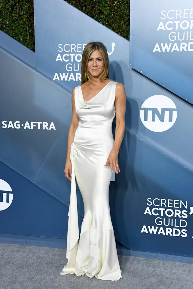 <p>Wearing a sultry white vintage Christian Dior gown and Fred Leighton jewelry.</p>