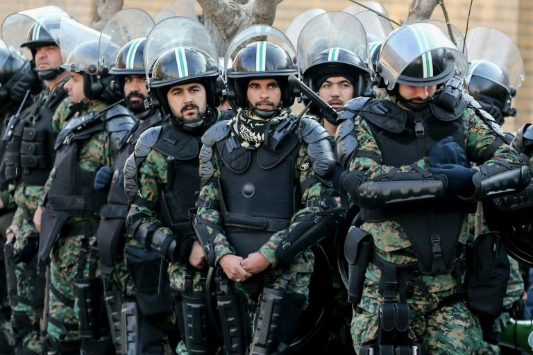 Iranian security forces in front of the British embassy in the capital Tehran during demonstrations following the British ambassador's arrest for allegedly attending an illegal demonstration (AFP Photo/ATTA KENARE)