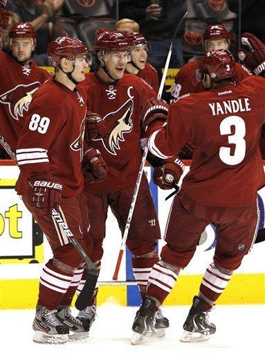 Phoenix Coyotes' Shane Doan, center, celebrates his goal against the New York Islanders with teammates Mikkel Boedker (89), of Denmark, and Keith Yandle (3) during the second period in an NHL hockey game on Saturday, Jan. 7, 2012, in Glendale, Ariz. (AP Photo/Ross D. Franklin)