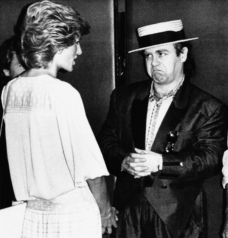 Britains Diana, Princess of Wales, left, meets rock star Elton John on her arrival at Wembley Stadium for the London end of the Live Aid famine relief concert for Africa, which was being relayed by TV to the world from there and Philadelphia, July 13, 1985, London, England. (AP Photo/Rota/Pool)