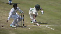 South Africa's Temba Bavuma is almost run out on day three of the first cricket test match between South Africa and Sri Lanka at Super Sport Park Stadium in Pretoria, South Africa, Monday, Dec. 28, 2020. (AP Photo/Catherine Kotze)