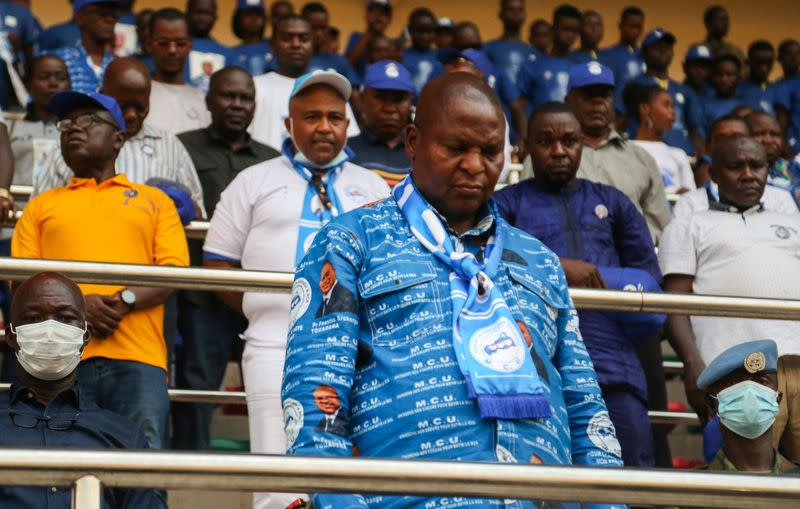 Central African Republic President Faustin Archange Touadera stands at a political rally at the stadium in Bangui