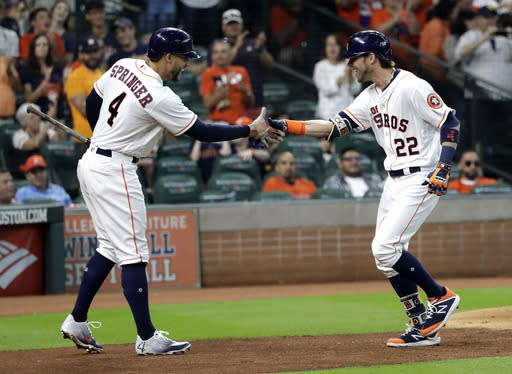 Houston Astros' Josh Reddick (22) celebrates with George Springer (4) after hitting a home run against the Arizona Diamondbacks during the second inning of a baseball game Saturday, Sept. 15, 2018, in Houston. (AP Photo/David J. Phillip)