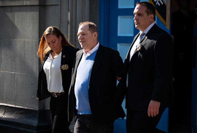 Harvey Weinstein, former co-chairman of the Weinstein Co., center, is escorted in handcuffs from the NYPD's 1st Precinct in New York on May 25.  <span>(</span>Photo: Mark Kauzlarich/Bloomberg via Getty Images)