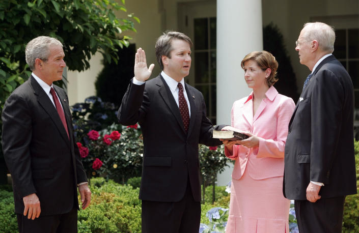 <p> FILE - In this June 1, 2006 file photo, from left to right, President Bush, watches the swearing-in of Brett Kavanaugh as Judge for the U.S. Court of Appeals for the District of Columbia by U.S. Supreme Court Associate Justice Anthony M. Kennedy, far right, during a ceremony in the Rose Garden of the White House, in Washington. Holding the Bible is Kavanaugh's wife Ashley Kavanaugh. Kavanaugh has been a conservative team player, and the Supreme Court nominee has stepped up to make a play at key moments in politics, government and the law dating to the Bill Clinton era. (AP Photo/Pablo Martinez Monsivais, File) </p>