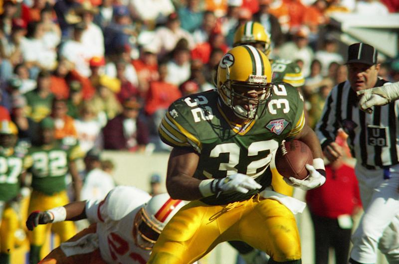 TAMPA, FL - DECEMBER 24: Running Back Reggie Cobb #32 of the Green Bay Packers breaks a tackle by Linbacker Marty Carter #23 of the Tampa Bay Buccaneers and runs for a few extra yards during a NFL game at Tampa Stadium on December 24, 1994 in Tampa, Florida. Green Bay won the game 34-19. (Photo by Michael J. Minardi/Getty Images)