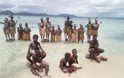 Students attend a climate change protest in Marovo Island, Solomon Islands - Credit: Reuters