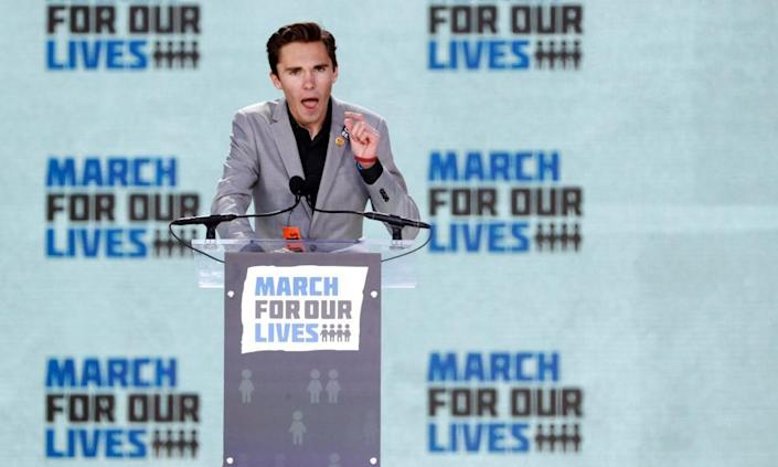 <span>David Hogg, a student at the Marjory Stoneman Douglas high school, speaking at the March for Our Lives event.</span> <span>Photograph: Aaron P. Bernstein/Reuters</span>