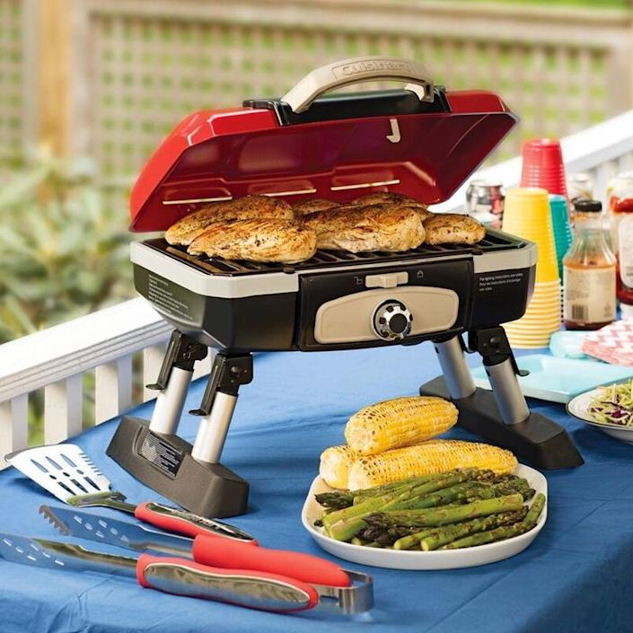 """<p><strong>Cuisinart</strong></p><p>amazon.com</p><p><strong>$112.94</strong></p><p><a href=""""https://www.amazon.com/dp/B004H4WWA6?tag=syn-yahoo-20&ascsubtag=%5Bartid%7C10055.g.27116208%5Bsrc%7Cyahoo-us"""" rel=""""nofollow noopener"""" target=""""_blank"""" data-ylk=""""slk:Shop Now"""" class=""""link rapid-noclick-resp"""">Shop Now</a></p><p>He can tote this tabletop grill from one tailgate to the next, which makes it a football season must-have. Although the cooktop on this foldable grill looks small, it can actually cook 8 burgers or steaks at once.</p>"""