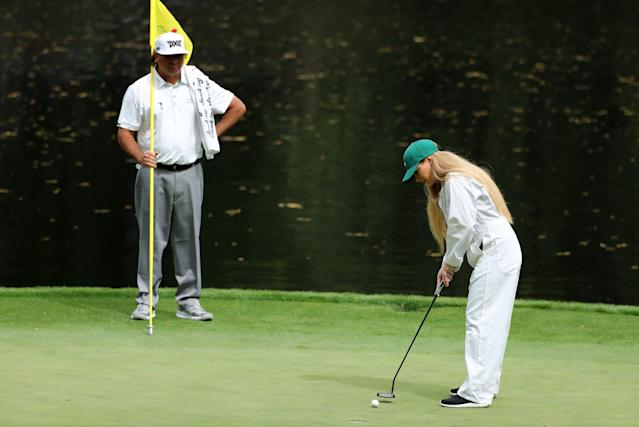 Pat Perez of the U.S. watches as his wife Ashley putts on the 9th green during the par 3 contest held on the final day of practice for the 2018 Masters golf tournament at Augusta National Golf Club in Augusta, Georgia, U.S. April 4, 2018. REUTERS/Lucy Nicholson