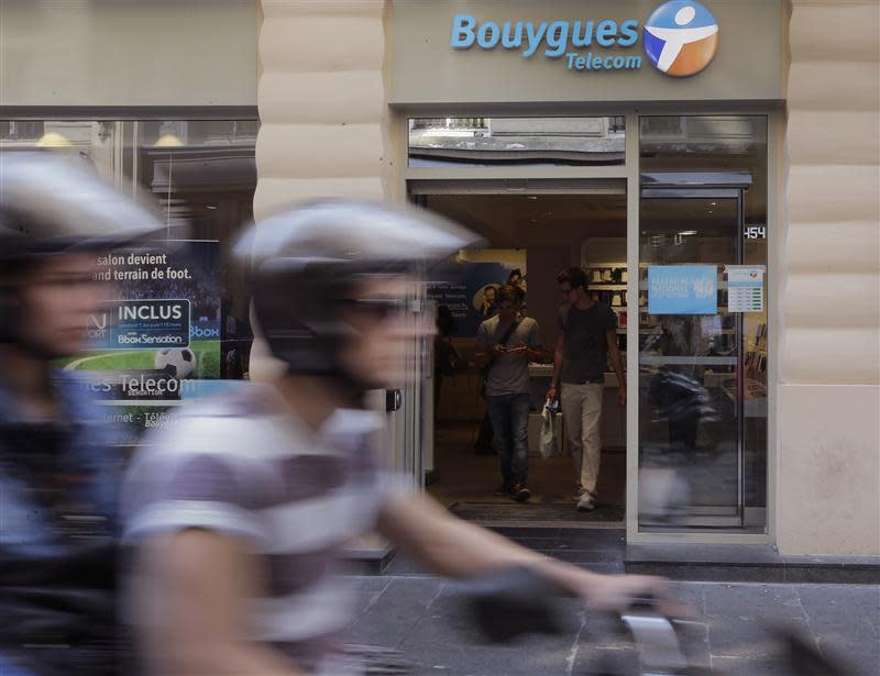 Customers are seen inside a Bouygues Telecom store in Paris