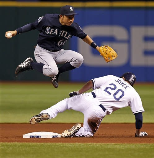 Tampa Bay Rays' Matt Joyce (20) slides in to break up an attempted double play throw to first base from Seattle Mariners shortstop Munenori Kawasaki on a hit by Hideki Matsui during the fourth inning of a baseball game Saturday, July 21, 2012, in St. Petersburg, Fla. (AP Photo/Mike Carlson)