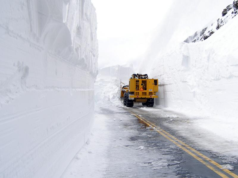 FILE - In this May 13, 2011 photo released by the National Park Service, a vehicle faces 23 feet of snow at Rock Cut on Trail Ridge Road in Rocky Mountain National Park in Colorado. It's almost June and the snow keeps falling in the Rockies, adding to record snowpack in some areas that could mean major flooding come spring melt. Mountains in northern Utah are expected to see up to a foot of fresh snow this week with a weather system that is dropping rain across the valley and will soon head east toward Colorado and Wyoming where high elevations could also see up to a foot of fresh snow. (AP Photo/National Park Service, File)