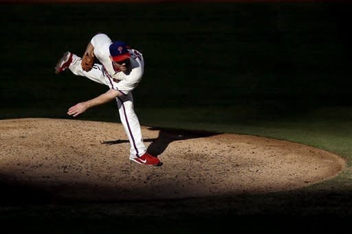 Philadelphia Phillies' Cliff Lee follows through after a pitch in the fourth inning of a baseball game against the Miami Marlins, Wednesday, Sept. 12, 2012, in Philadelphia. (AP Photo/Matt Slocum)