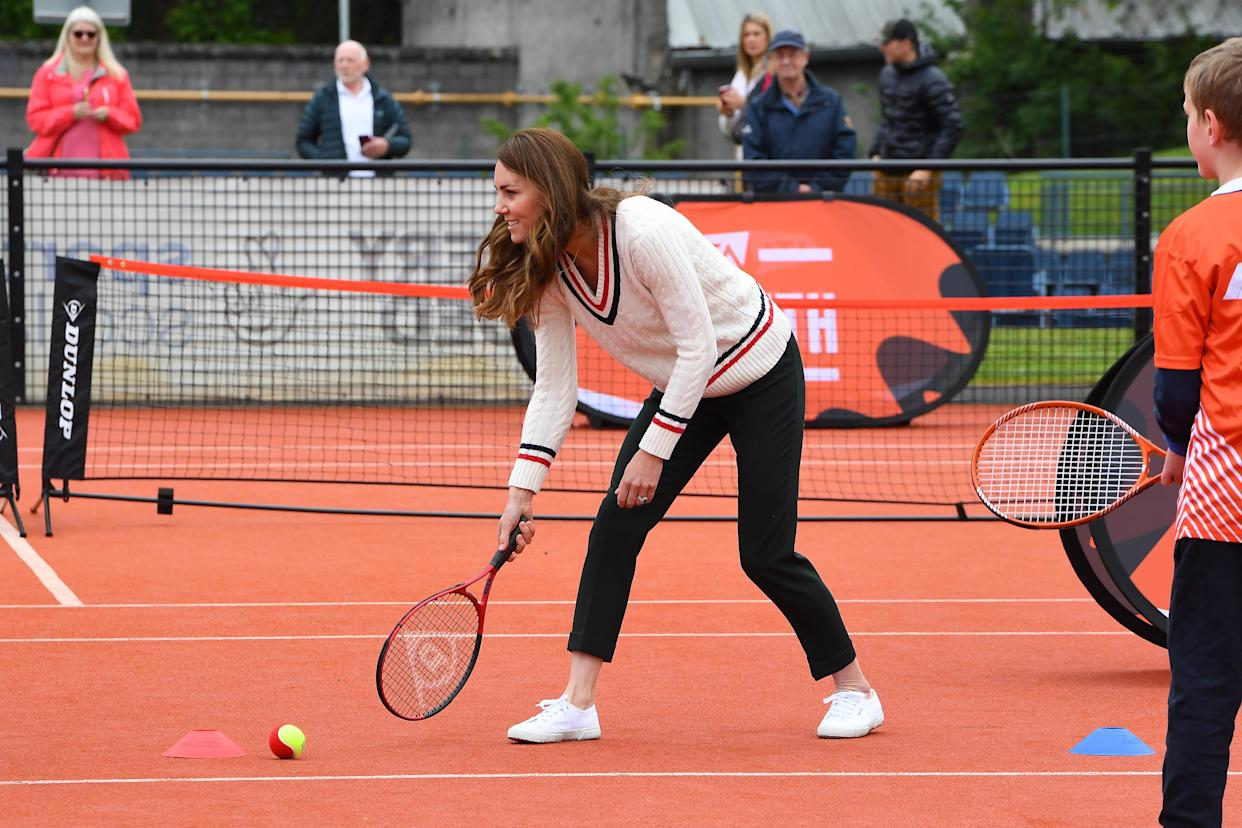 EDINBURGH, SCOTLAND - MAY 27: Catherine, Duchess of Cambridge plays tennis games with schoolchildren as they take part in the Lawn Tennis Association's (LTA) Youth programme, at Craiglockhart Tennis Centre on May 26, 2021 in Edinburgh, Scotland. (Photo by Andy Buchanan - WPA Pool/Getty Images)