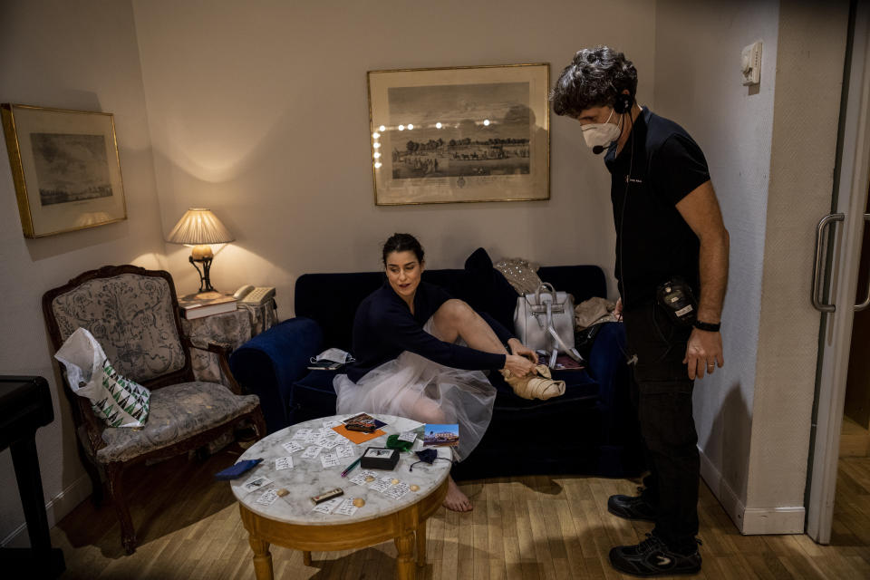 "Lithuanian soprano Asmik Grigorian, left, talks with stage manager Hugo Fernandez in a dressing room prior to a performance of ""Rusalka"" at the Teatro Real in Madrid, Spain, on Thursday, Nov. 12, 2020. The theater is one of the few major opera houses that have reopened during the coronavirus pandemic, although to smaller audiences. (AP Photo/Bernat Armangue)"