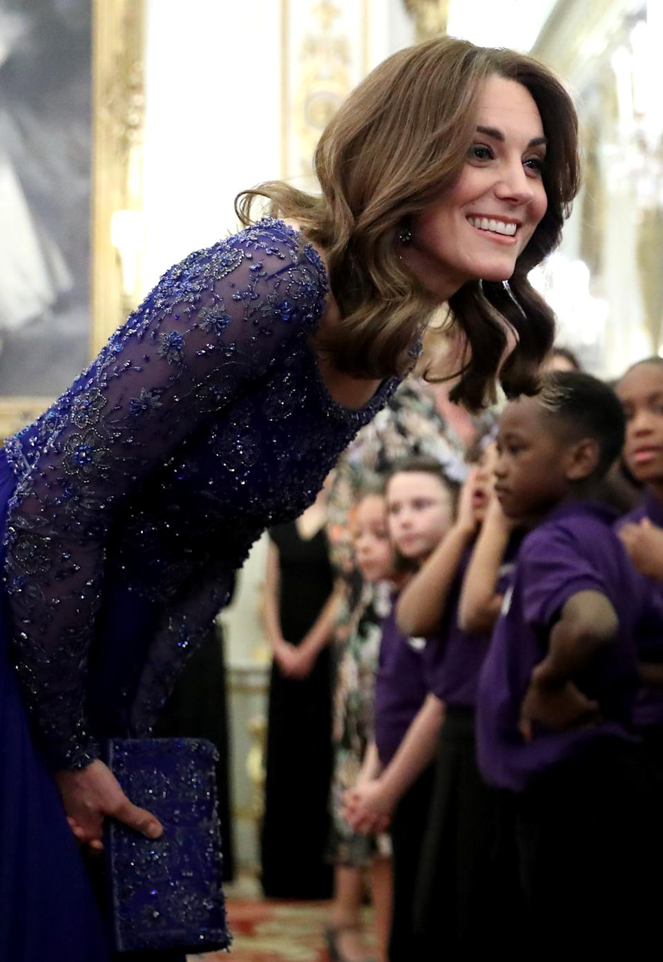 LONDON, ENGLAND - MARCH 09: Catherine, Duchess of Cambridge speaks with a school choir as she hosts a Gala Dinner in celebration of the 25th anniversary of Place2Be at Buckingham Palace on March 09, 2020 in London, England. The Duchess is Patron of Place2Be, which provides emotional support at an early age and believes no child should face mental health difficulties alone. (Photo by Chris Jackson - WPA Pool/Getty Images)