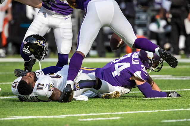 <p>Baltimore Ravens wide receiver Mike Wallace (17) loses his helmet following a hit from Minnesota Vikings safety Andrew Sendejo (34) during the first quarter at U.S. Bank Stadium. Mandatory Credit: Brace Hemmelgarn-USA TODAY Sports </p>