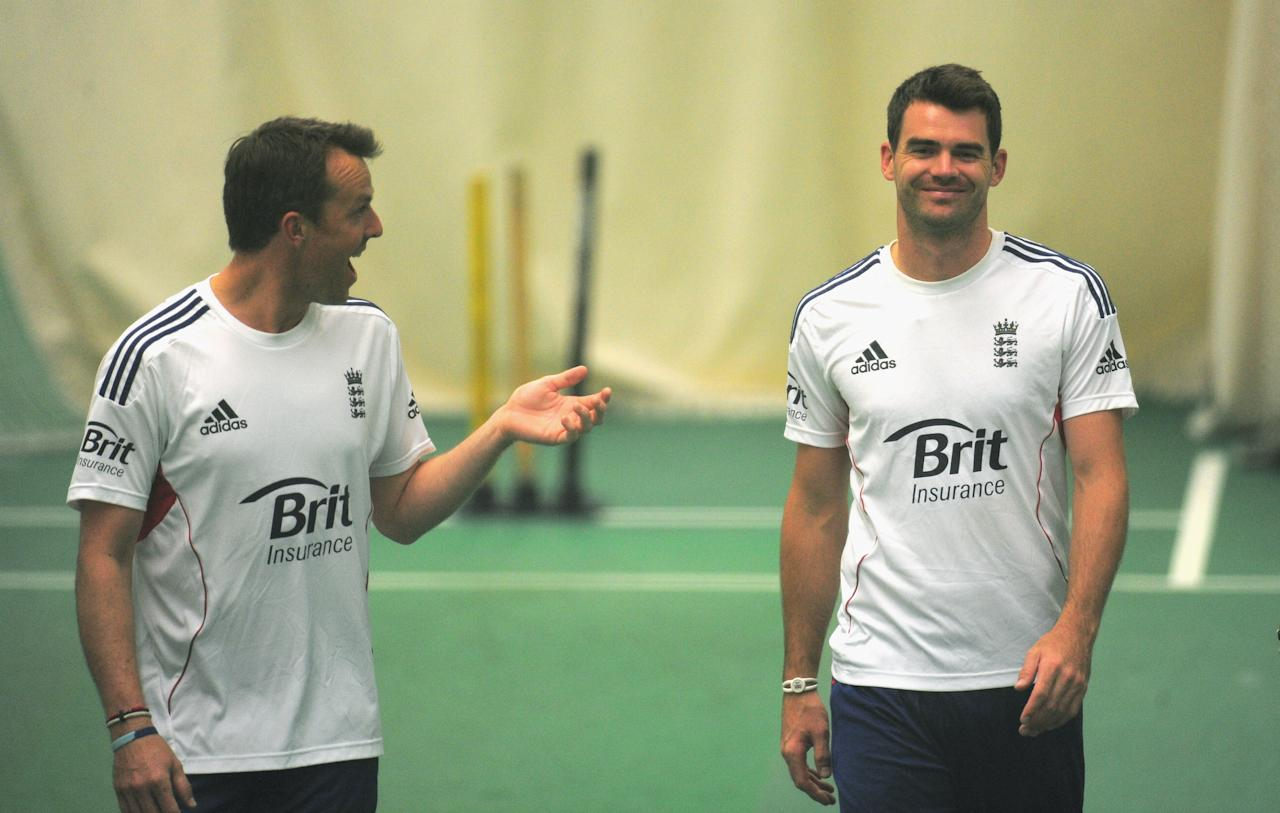 MANCHESTER, ENGLAND - JULY 31:  England player James Anderson (r) shares a joke with Graeme Swann during an England nets ahead of the third ashes test match at Old Trafford on July 31, 2013 in Manchester, England.  (Photo by Stu Forster/Getty Images)