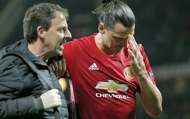 Zlatan Ibrahimovic is helped off the pitch on Thursday night during Manchester United's defeat of Anderlecht in the second leg of their Europa League quarter-final - Rex Features