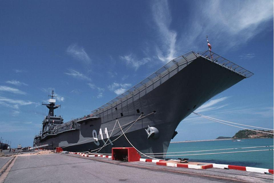 "<p>Thailand's carrier, the <em>Chakri Naruebet, </em>was named in honor of the Thai royal dynasty. This isn't just Southeast Asia's only carrier—it's also the only one with a royal suite built for a king.</p><p><em>Chakri Naruebet</em> was constructed in a Spanish shipyard and based on Spain's <em>Principe de Asturias</em> (since retired). At 597 feet long and displacing 11,400 tons fully loaded, she's one of the smallest carriers around. <em>Chakri Naruebet</em> originally had an air wing of nine Harrier jets, but a lack of spare parts has permanently grounded the entire fleet. The working remainder of her air wing consists of 4 <a href=""https://en.wikipedia.org/wiki/Sikorsky_SH-60_Seahawk"" rel=""nofollow noopener"" target=""_blank"" data-ylk=""slk:SH-60 Seahawk helicopters"" class=""link rapid-noclick-resp"">SH-60 Seahawk helicopters</a>.</p><p>As a flat top, Chakri Naruebet is minimally operational. Budget cuts have resulted in the carrier operating outside of its naval base at Sattahip for only one day a month. Without its Harriers, the ship is more apt to carry the king and his entourage for royal cruises than to embark on military exercises, which has led to it being dubbed ""The World's Largest Royal Yacht.""</p>"