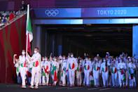 <p>TOKYO, JAPAN - JULY 23: Flag bearers Jessica Rossi and Elia Viviani of Team Italy lead their team out during the Opening Ceremony of the Tokyo 2020 Olympic Games at Olympic Stadium on July 23, 2021 in Tokyo, Japan. (Photo by Jamie Squire/Getty Images)</p>