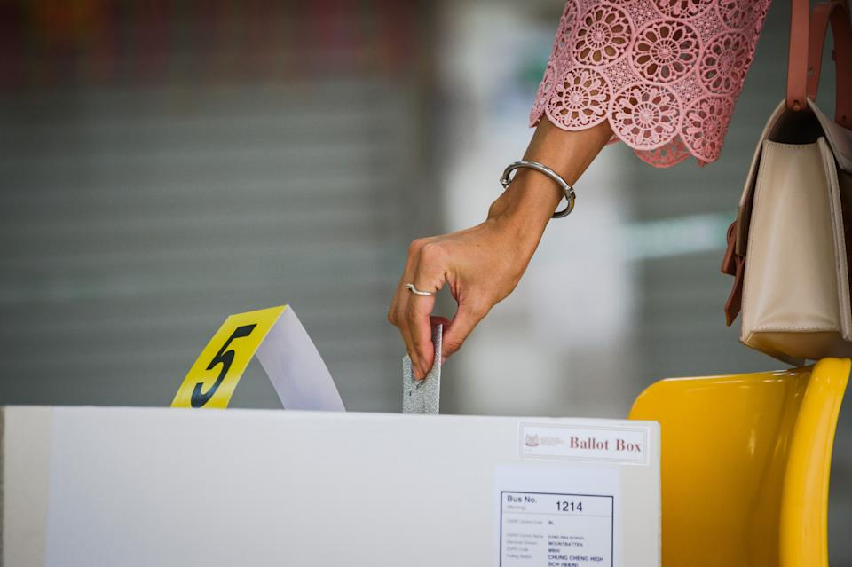 A woman casting her vote at the Chung Cheng High School polling centre on 10 July. (PHOTO: Joseph Nair for Yahoo News Singapore)