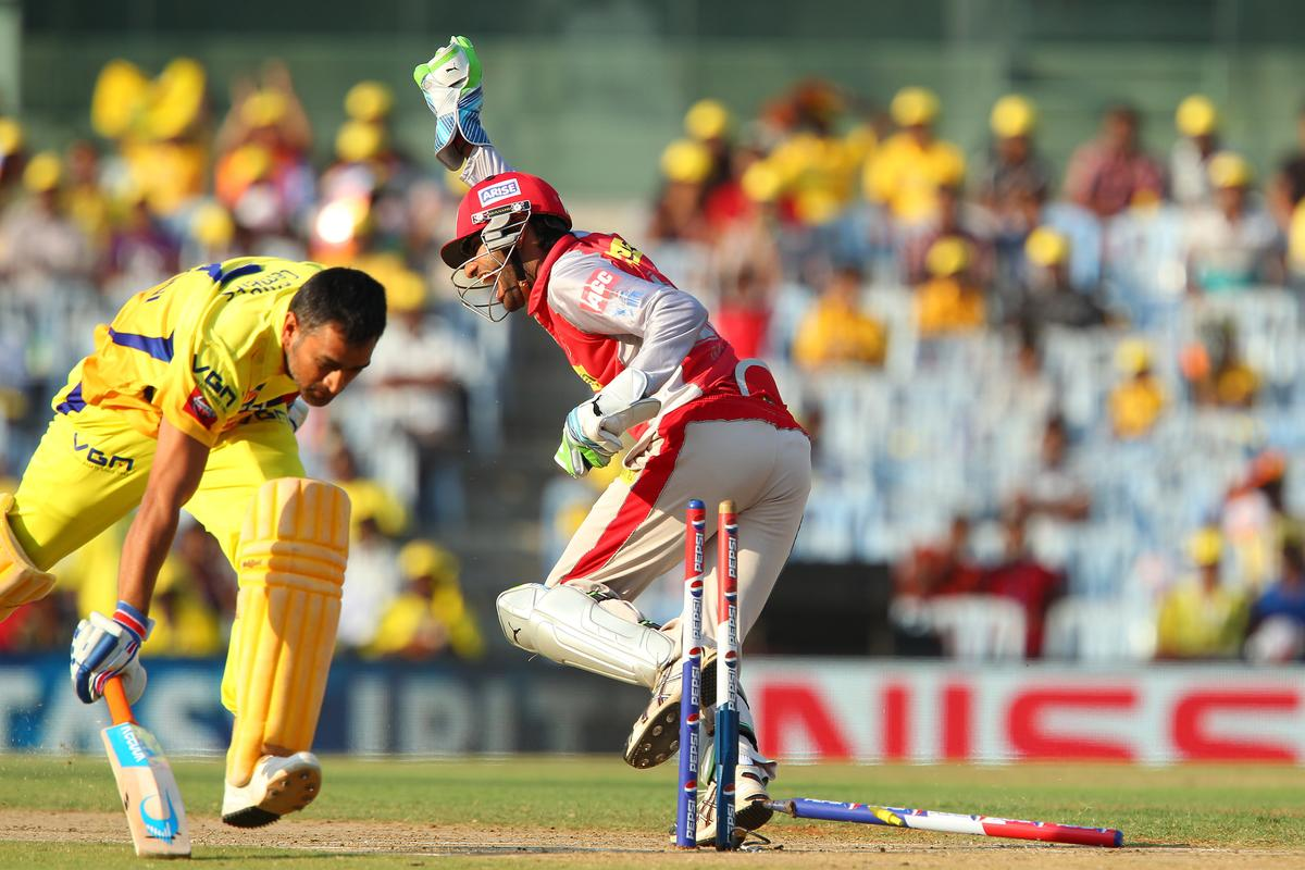 Gurkeerat Singh runs out MS Dhoni during match 45 of the Pepsi Indian Premier League between The Chennai Superkings and the Kings XI Punjab held at the MA Chidambaram Stadium in Chennai on the 2nd May 2013..Photo by Ron Gaunt-IPL-SPORTZPICS   .. .Use of this image is subject to the terms and conditions as outlined by the BCCI. These terms can be found by following this link:..https://ec.yimg.com/ec?url=http%3a%2f%2fwww.sportzpics.co.za%2fimage%2fI0000SoRagM2cIEc&t=1490569002&sig=E.IVWMptS2eMTEzeTMiQcQ--~C