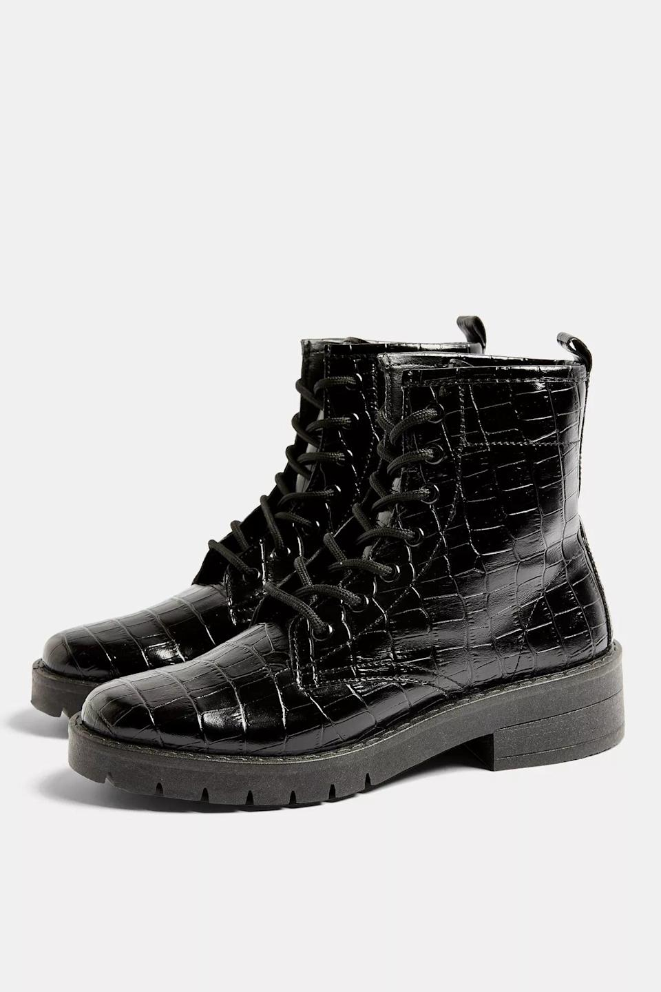 <p>You'll want to take these <span>Black Crocodile Lace Up Boots</span> ($75) everywhere.</p>