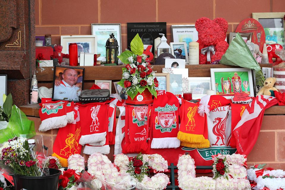 <p>Tributes at the Hillsborough Memorial outside Anfield stadium in Liverpool</p> (PA Wire)